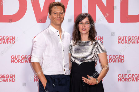 Stock Image of Alexander Fehling (L) and Nora Tschirner (R) pose for a photo on the red carpet prior to a Family and Friends Preview of 'Gut gegen Nordwind' in Berlin, Germany, 04 September 2019. The movie opens in German theaters on 12 September.
