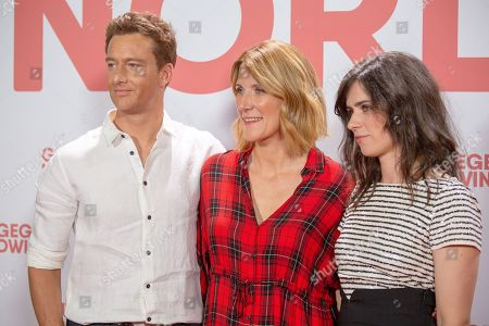 Alexander Fehling (L), German film director Vanessa Jopp (C) and German actress/cast member Nora Tschirner (R) pose for a photo on the red carpet prior to a Family and Friends Preview of 'Gut gegen Nordwind' in Berlin, Germany, 04 September 2019. The movie opens in German theaters on 12 September.