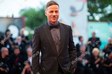 Tom Wlaschiha poses for photographers upon arrival at the premiere of the film 'Saturday Fiction' at the 76th edition of the Venice Film Festival, Venice, Italy