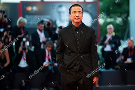 Lou Ye poses for photographers upon arrival at the premiere of the film 'Saturday Fiction' at the 76th edition of the Venice Film Festival, Venice, Italy