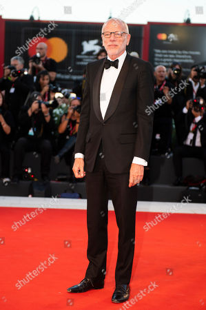 Pascal Greggory poses for photographers upon arrival at the premiere of the film 'Saturday Fiction' at the 76th edition of the Venice Film Festival, Venice, Italy