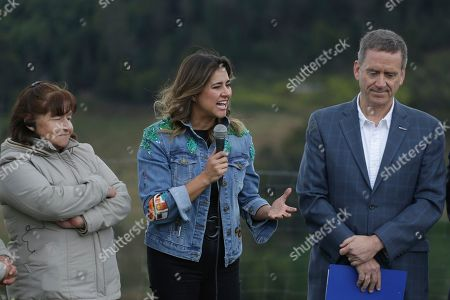 Colombian first lady Maria Juliana Ruiz speaks during a visit to a women-owned strawberry farm in Usme, Colombia, during a visit by Ivanka Trump who is on a South America trip that aims to promote women's empowerment. At left is farm owner Alicia Epinosa, and Mark Green, world USAID administrator