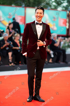 Mark Chao poses for photographers upon arrival at the premiere of the film 'Saturday Fiction' at the 76th edition of the Venice Film Festival, Venice, Italy