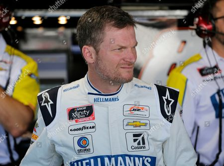 Dale Earnhardt Jr. looks on in the garage before practice for NASCAR auto race, in Darlington, S.C