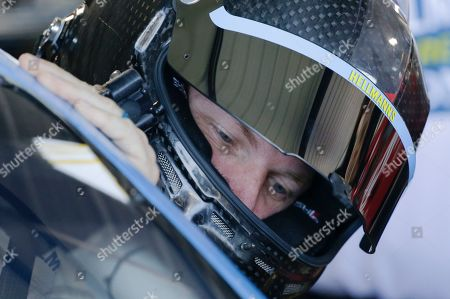 Dale Earnhardt Jr. gets in his car before practice for a NASCAR Xfinity Series auto race at Darlington Raceway, in Darlington, S.C