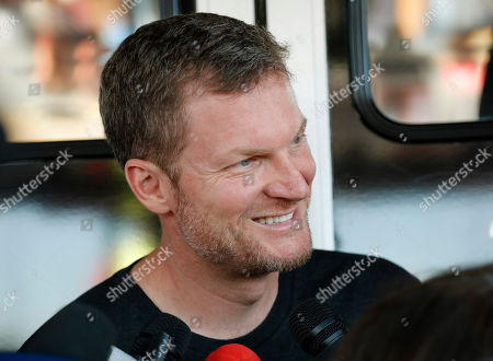 Stock Photo of Dale Earnhardt Jr. talks with the media in the garage area before practice for a NASCAR auto race, in Darlington, S.C