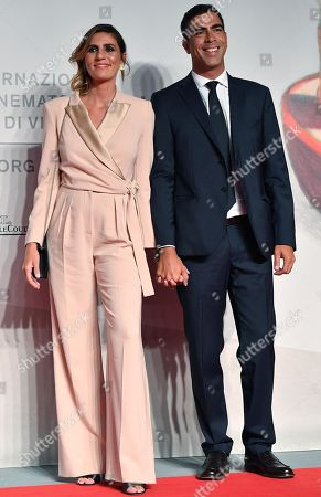 Elisa Amoruso (L) and Gianluigi Zamponi (R) arrive for the premiere of 'Chiara Ferragni - Unposted' during the 76th annual Venice International Film Festival, in Venice, Italy, 04 September 2019. The movie is presented in the 'Sconfini' section at the festival running from 28 August to 07 September.