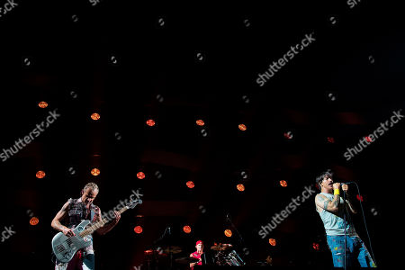 From left, Flea, Chad Smith and Anthony Kiedis of the Red Hot Chili Peppers perform at a concert in Abu Dhabi, United Arab Emirates