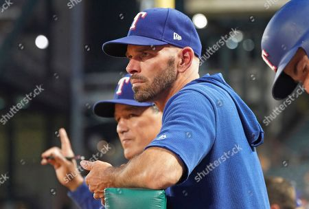 Texas Rangers manager Chris Woodward is pictured in the dugout during a baseball game against the Seattle Mariners, in Arlington, Texas