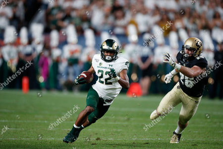 R m. Colorado State Rams wide receiver Dante Wright (22) pursued by Colorado Buffaloes cornerback Dylan Thomas (28) in the second quarter of an NCAA college football game, in Denver