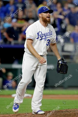 Kansas City Royals relief pitcher Ian Kennedy celebrates after the team's baseball game against the Detroit Tigers, in Kansas City, Mo. The Royals won 5-4