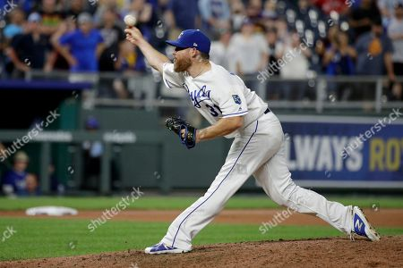 Kansas City Royals relief pitcher Ian Kennedy throws during the ninth inning of the team's baseball game against the Detroit Tigers, in Kansas City, Mo. The Royals won 5-4
