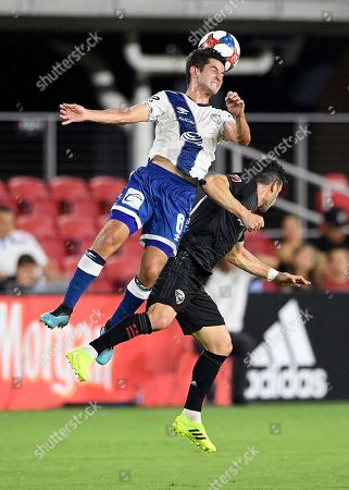 Puebla midfielder Daniel Lajud (6) heads the ball over D.C. United midfielder Felipe Martins, right, during the first half of a friendly soccer match, in Washington