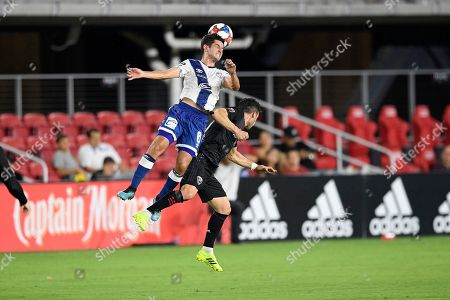 Stock Photo of Puebla midfielder Daniel Lajud (6) heads the ball against D.C. United midfielder Felipe Martins, right, during the first half of an international friendly soccer match, in Washington