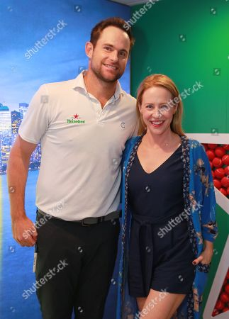 Andy Roddick and Amy Hargreaves stop by the Heineken suite at the U.S. Open