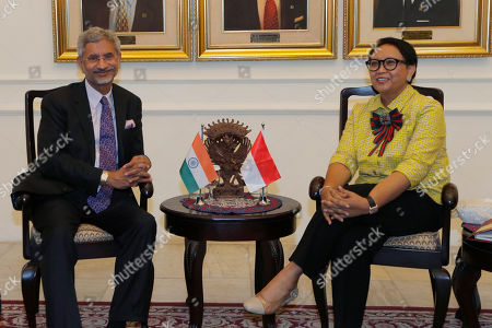 Indian Foreign Minister Subrahmanyam Jaishankar, left, talks with his Indonesian counterpart Retno Marsudi during their meeting in Jakarta, Indonesia