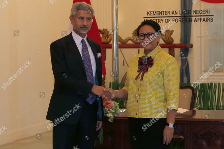 Indian Foreign Minister Subrahmanyam Jaishankar, left, is greeted by his Indonesian counterpart Retno Marsudi prior their meeting in Jakarta, Indonesia