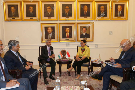 Indian Foreign Minister Subrahmanyam Jaishankar, center left, talks with his Indonesian counterpart Retno Marsudi during their meeting in Jakarta, Indonesia