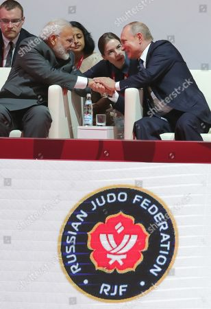 Indian Prime Minister Narendra Modi (front L) and Russian President Vladimir Putin (front R) shake hands before the International Jigoro Kano Judo tournament on the sidelines the Eastern Economic Forum 2019 in Vladivostok, Russia, 05 September 2019. The far-eastern Russian city of Vladivostok hosts the Eastern Economic Forum 2019 from 4 to 6 September.