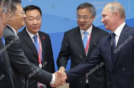 Russian President Vladimir Putin (R) shakes hands with an unidentified Chinese official as Chinese Vice Premier Hu Chunhua (2-R)  looks on during a meeting on the sidelines of the Eastern Economic Forum 2019 in Vladivostok, Russia, 05 September 2019. The Eastern Economic Forum 2019 takes place in Vladivostok from 04 to 06 September.