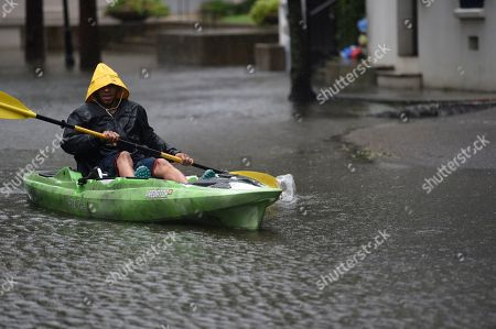Johnny Crawford navigates his kayak down a flooded street, in Charleston, S.C., following Hurricane Dorian. The downtown neighborhood is prone to floodwaters, even without a tropical weather event