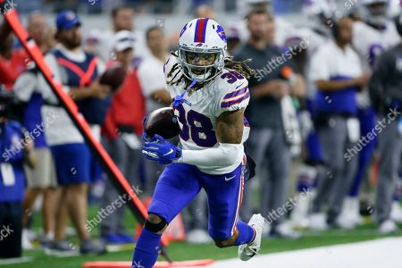 Stock Photo of Buffalo Bills cornerback Ryan Lewis (38) carries the ball against the Detroit Lions during the second half of an NFL preseason football game in Detroit