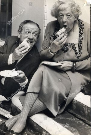 Sid James And Dame Margaret Rutherford Are Pictured Eating Birthday Cake At London's Saville Theatre Where They Held A Party To Celebrate Their Birthdays. Dame Rutherford Is 73 Sid Was 52 Several Days Ago. Syd James