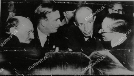 WWII: Peace: San Francisco Conference. Picture shows: Four members of the British delegation hold an impromptu session at the UNCIO (United Nations Conference on International Organisation) in San Francisco, where a difficulty has arisen over Vyacheslav Molotov's attitude in regard to the chairmanship. L-R: Clement Attlee, Anthony Eden, Lord Halifax and Lord Cranborne