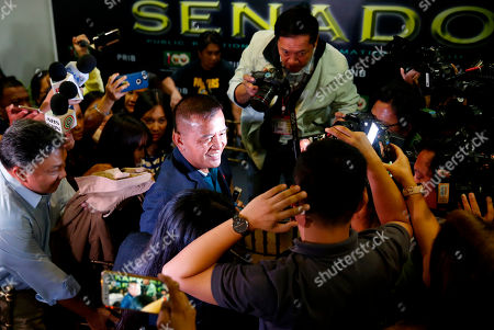 Nicanor Faeldon, the Director-General of the Bureau of Corrections who was fired by President Rodrigo Duterte the night before, is hounded by the media as he arrives at the Philippine Senate for the continuing probe in the failed release of former Mayor Antonio Sanchez who was convicted in the 1993 rape and murders of two students in suburban Pasay city south of Manila, Philippines. President Duterte has fired Faeldon Wednesday amid a public outcry over the release of hundreds of prisoners, including convicted rapists and drug traffickers, through a law rewarding good behavior in detention
