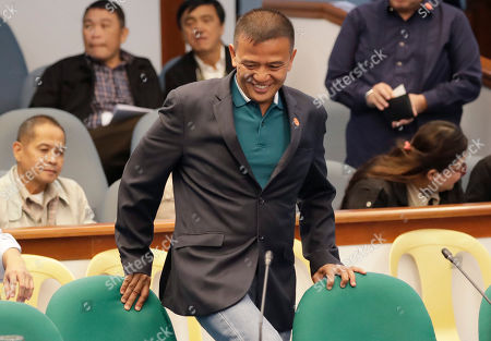 Nicanor Faeldon, the Director-General of the Bureau of Corrections who was fired by President Rodrigo Duterte the night before, takes his seat as he arrives at the Philippine Senate, for the continuing probe in the failed release of former Mayor Antonio Sanchez who was convicted in the 1993 rape and murders of two students in suburban Pasay city south of Manila, Philippines. President Duterte has fired Faeldon Wednesday amid a public outcry over the release of hundreds of prisoners, including convicted rapists and drug traffickers, through a law rewarding good behavior in detention