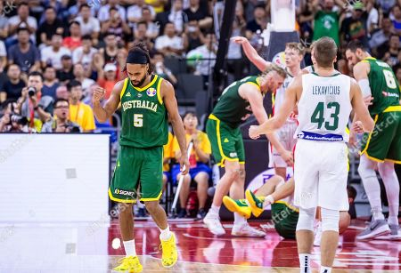 Patty Mills (L) of Australia reacts after scoring during the FIBA Basketball World Cup 2019 group H match between Lithuania and Australia in Dongguan, China, 05 September 2019.