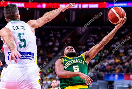 Mantas Kalnietis (L) of Lithuania in action against Patty Mills (R) of Australia during the FIBA Basketball World Cup 2019 group H match between Lithuania and Australia in Dongguan, China, 05 September 2019.