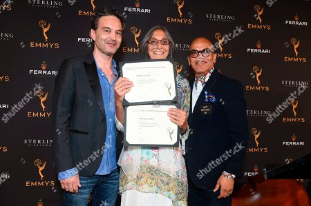 """Stock Image of Miriam Cutler, Jeff Russo, Rickey Minor. Composer Miriam Cutler celebrates her two Emmy nominations for the music she wrote for two of the years' notable documentaries, """"Love, Gilda"""" and """"The Notorious RBG"""" with Governors Jeff Russo, left, and Rickey Minor at the 2019 Music Nominee Reception at the Television Academy Wolf Theatre on in North Hollywood, Calif"""