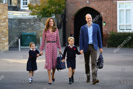 Britain's Princess Charlotte, left, with her brother Prince George and their parents Prince William and Kate, Duchess of Cambridge, arrives for her first day of school at Thomas's Battersea in London