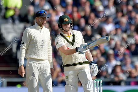 Australia's Steve Smith points out a distraction in the crowd to England?s Joe Root during the second day of the fourth Specsavers Ashes test series at Old Trafford, Manchester, UK