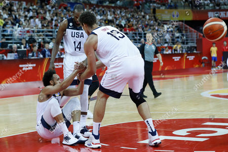 Khris Middleton of USA (C) and Brook Lopez of USA (R) help teammate Donovan Mitchell of USA during the FIBA Basketball World Cup 2019 group E first ?round? match between USA and Japan in Shanghai, China, 05 September 2019.