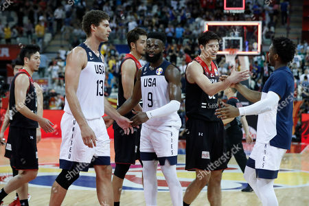 Donovan Mitchell of USA (R) shakes hands with Avi Koki Schafer of Japan (2-R) after the FIBA Basketball World Cup 2019 group E first ?round? match between USA and Japan in Shanghai, China, 05 September 2019.
