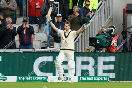 Wicket - Steve Smith of Australia is out for 211 off the bowling of Joe Root of England and he raises his arms and bat as he leaves the field during the International Test Match 2019, fourth test, day two match between England and Australia at Old Trafford, Manchester