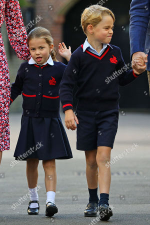 Stock Image of Princess Charlotte, waves as she arrives for her first day at school, with her brother Prince George
