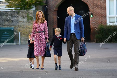 Princess Charlotte, hide behind her mother Catherine Duchess of Cambridge as she arrives for her first day at school, with her brother Prince George and her father Prince William  at Thomas's Battersea in London.