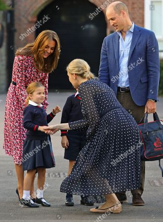 Helen Haslem, head of the lower school greets   Princess Charlotte as she arrives for her first day of school, with her brother Prince George (hidden) and her parents the Duke and Catherine Duchess of Cambridge, at Thomas's Battersea in London.