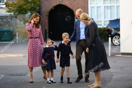 Helen Haslem (right), head of the lower school greets Princess Charlotte as she arrives for her first day of school, with her brother Prince George and her parents the Duke and Catherine Duchess of Cambridge, at Thomas's Battersea in London.