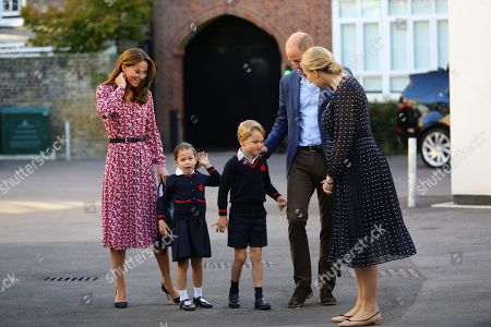 Helen Haslem (right), head of the lower school greets Princess Charlotte as she arrives for her first day of school at Thomas's Battersea in London, accompanied by her brother Prince George and her parents the Duke and Catherine Duchess of Cambridge.