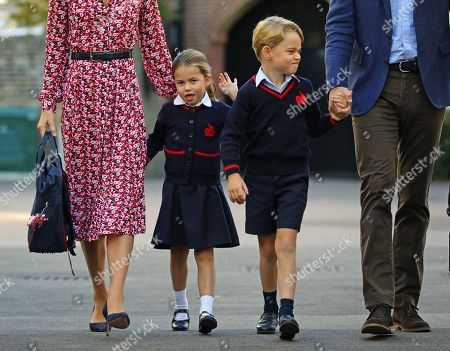 Princess Charlotte, waves as she arrives for her first day at school, with her brother Prince George