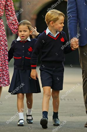 Princess Charlotte arrives for her first day at school, with her brother Prince George