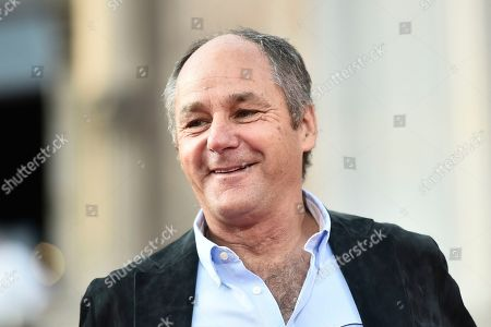 Former Formula One driver Gerhard Berger during the celebration of the 90th anniversary of Ferrari Foundation in Cathedral square in Milan