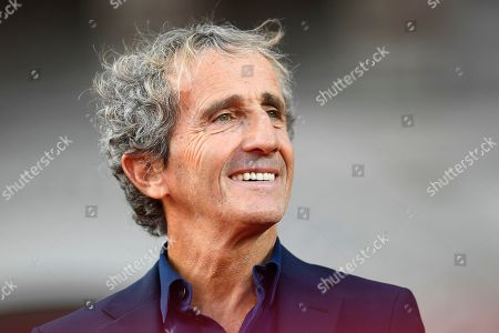 Former Formula Uno driver Alain Prost during the celebration of the 90th anniversary of Ferrari Foundation in Cathedral square in Milan
