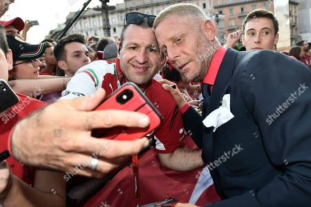 Lapo Elkann with fans during the celebration of the 90th anniversary of Ferrari Foundation in Cathedral square in Milan
