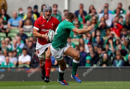 Jonathan Davies of Wales in action against Jordan Larmour of Ireland