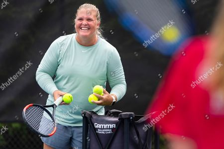 Retired tennis player Melanie Oudin coaches young players at Windward Lake Club, in Alpharetta, Ga. At 17 she made a run to the quarterfinals of the 2009 U.S. Open, beating Maria Sharapova and three other seeded players along the way